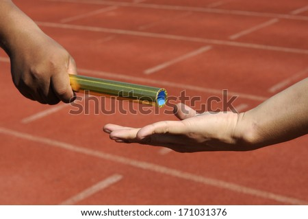 Relay-athletes hands sending action  - stock photo