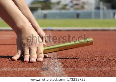 Relay-athletes hands starting action  - stock photo