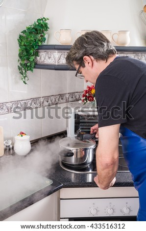 Releasing steam from a pressure cooker