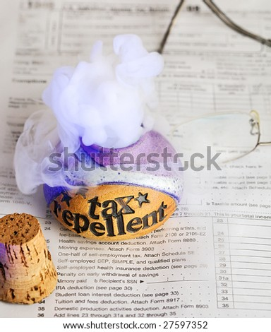 Releasing tax repellent on top of a 1040 income tax form - stock photo
