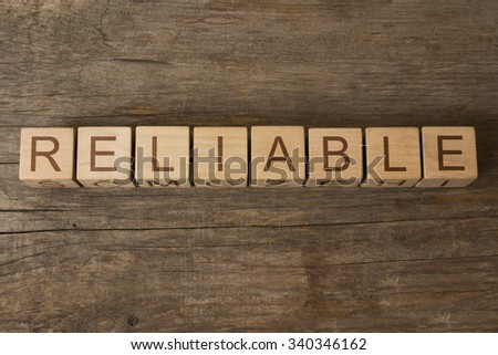 RELIABLE word on wooden blocks - stock photo