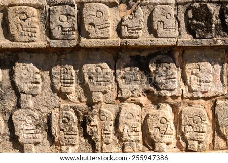 Relief at the Tzompantli in Chichen Itza. Mexico - stock photo