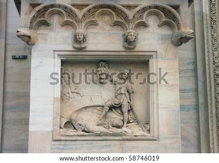 Relief of David killing Goliath, Duomo, Milan, Italy - stock photo