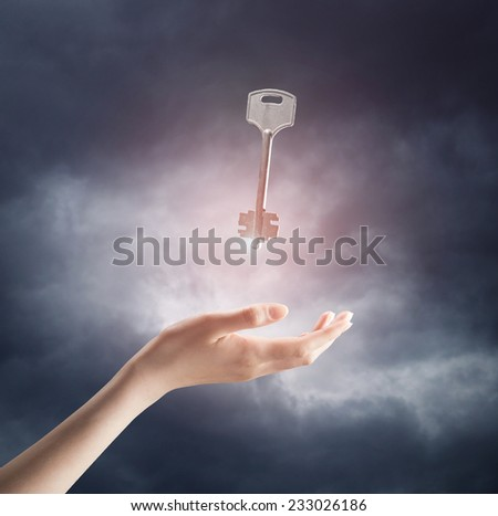religion concept. Close up of woman hand holding key - stock photo