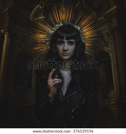 religion, karma concept, Virgin Mary with baseball bat with a golden crown and dressed black leather - stock photo