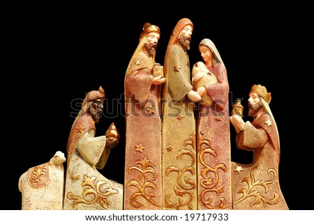 Religious christmas group with 3 kings, joseph, mary, baby jesus and a sheep on black background - stock photo