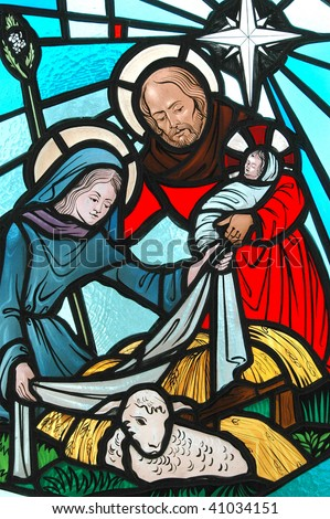 Religious christmas stained glass window. - stock photo