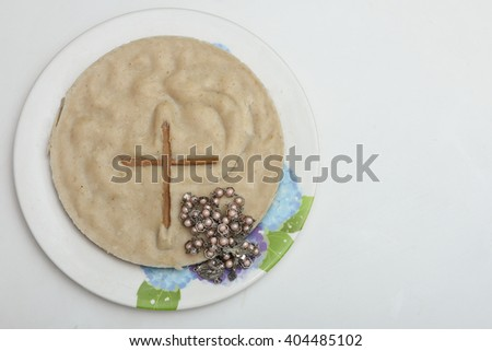 Religious food for Christians made of rice flour, on Happy / Good Friday, Kerala India. bread in eucharist of christian. Forgiveness, Rosary, Last Supper, Maundy Thursday, Easter Sunday hot cross buns - stock photo