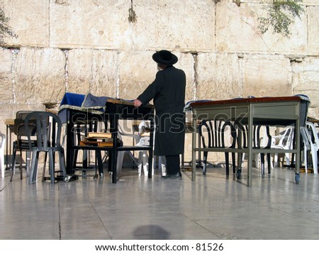 religious jew pray at the wailing wall in israel - stock photo