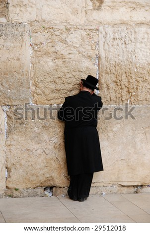 Religious jew praying at the Western Wall - stock photo