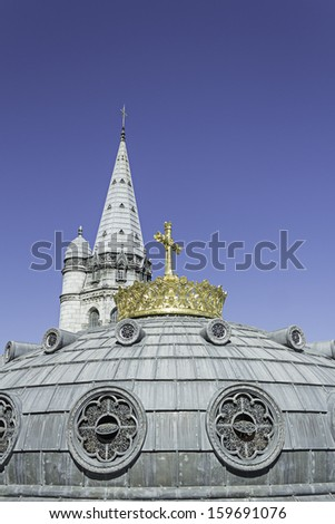 Religious Lourdes Cathedral in France, old building - stock photo