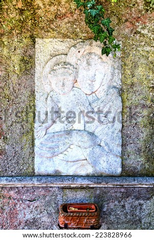Religious relief at a stony wall in Sirmione at the Lake Garda - stock photo