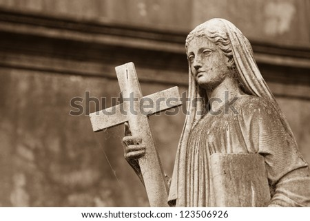 Religious Statue at the cemetery - stock photo