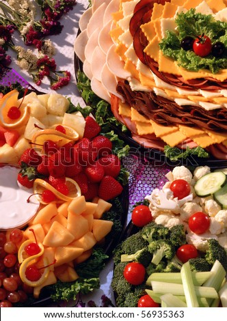 Relish, cheese, meat,  and fruit trays - stock photo