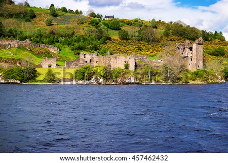 Remainings of the Urquhart Castle in Loch Ness, in Scotland. Loch Ness is a city in the Highlands in Scotland in the United Kingdom. - stock photo