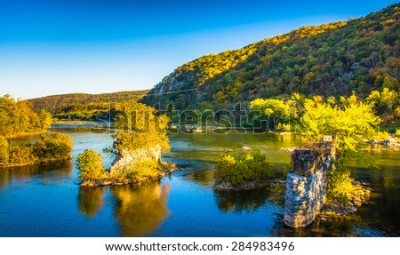 Remains of a bridge in the Shenandoah River, in Harper's Ferry, West Virginia. - stock photo