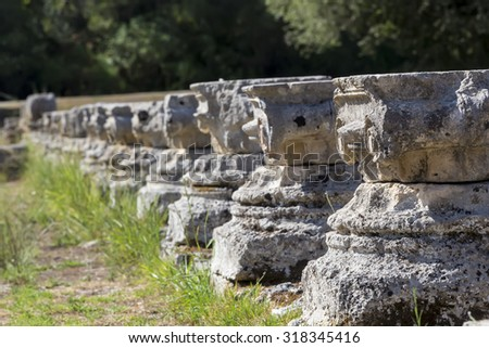 Remains of a Corinthian column in Olympia, Greece - stock photo