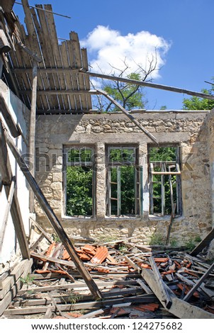 Remains of a house after an earthquake - stock photo