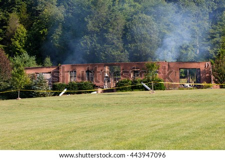 Remains of a house burned down by a fire - stock photo