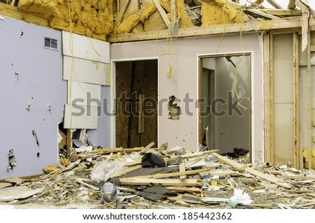 Remains of a house hit by a tornado - stock photo
