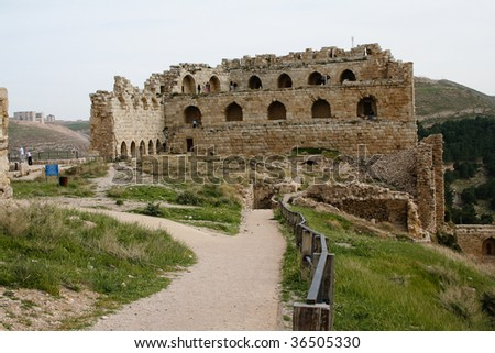 remains of an ancient castle on a hill with columns in Jordan
