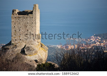 remains of an old tower on the island of Elba, with a sea view - stock photo