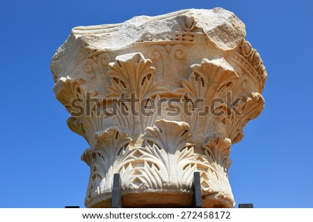 remains of ancient corinthian columns on a background of the blue sky, Caesarea Maritima national park, Israel - stock photo