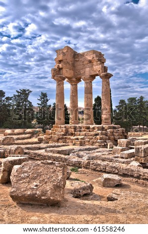 Remains of ancient Greek temple of Castor & Pollux, Agrigento, Sicily - stock photo