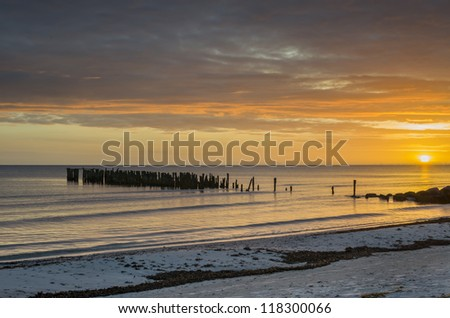 Remains of old marine pier, Baltic Sea, Europe - stock photo