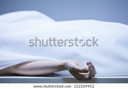 Remains of person in the morgue, horizontal - stock photo