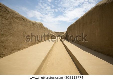 Remains of the archeological city of Chan Chan in Trujillo. Peru. The city used to be the capital of the Chimu Kingdom which reached its apogee in the 15th Century. It is a UNESCO World Heritage Site. - stock photo