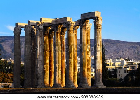 Remains of the columns of the temple of Olympian Zeus during a sunset in central Athens, Greece