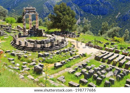 Remains of the temple dedicated to goddess Athena at Delphi, Greece - stock photo