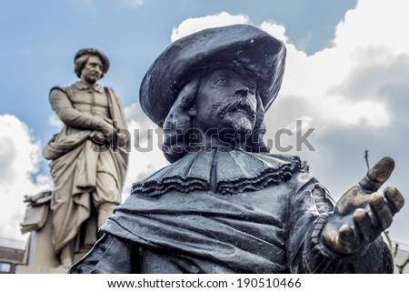 Rembrandt statue on Rembrandtplein (Rembrandt Square) both named after the famous painter Rembrandt van Rijn who owned a house nearby from 1639 to 1656 in Amsterdam, Netherlands - stock photo