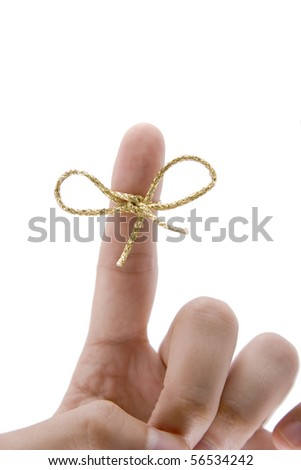 remember concept,  finger with gold tie on white background - stock photo