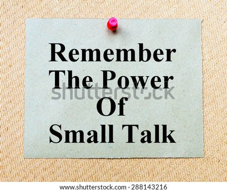 Remember The Power Of Small Talk written on paper note pinned with red thumbtack on wooden board. Business conceptual Image - stock photo