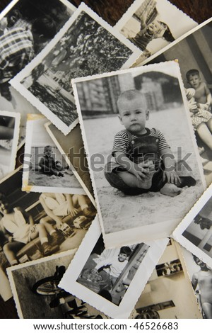 remembering childhood: stack of old photos - stock photo