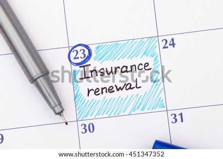 Reminder Insurance Renewal in calendar with pen.