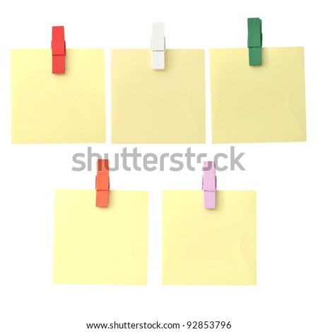 reminder note on color clothes pins on white background