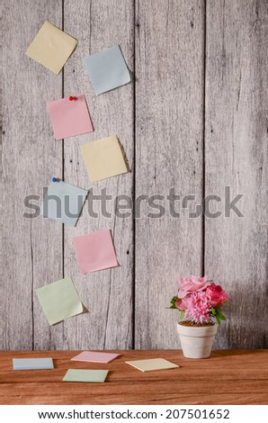 reminder note on old white wooden wall background - stock photo