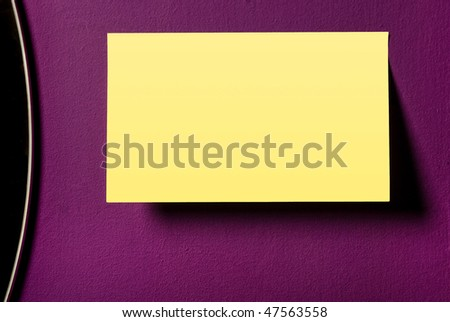reminder on violet wall - stock photo