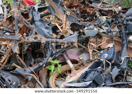 Remnants of the old motorbike piled together.