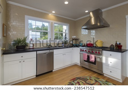 Remodeled Country style kitchen with all new appliances  - stock photo