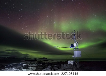 Remote automated weather science station and Aurora Borealis - Arctic, Spitsbergen - stock photo