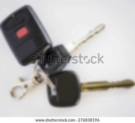 remote car key on white background,Image blur style