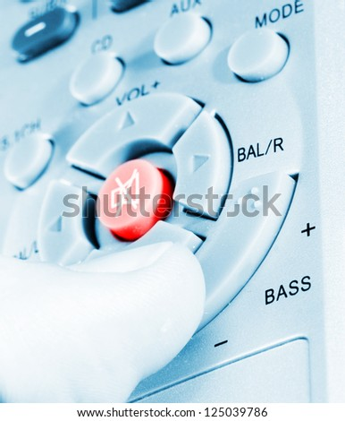 Remote Control in a man hand. Close up. - stock photo