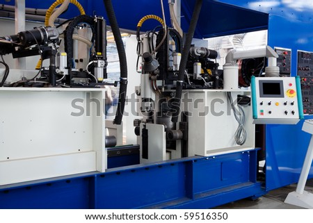 remote control of a new and modern metal machines - stock photo