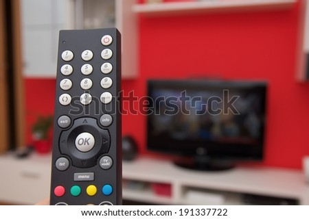 Remote control of internet TV - stock photo