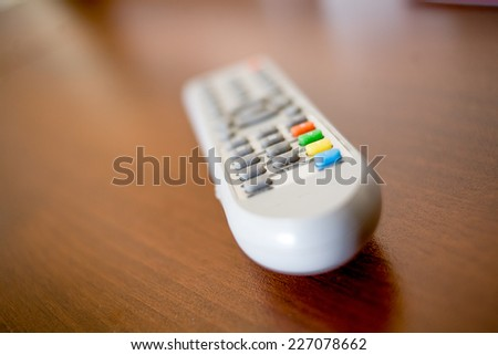 Remote  control on the table and a lot of copyspace, shallow dof - stock photo