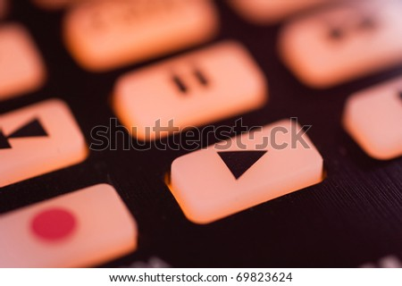 Remote control play button - stock photo